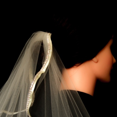 Ribbon with Rhinestones (00KB17T201) - Ivory with Ivory Ribbon. This veil has an extra touch of elegance with lovely chain rhinestones. (Closeup)