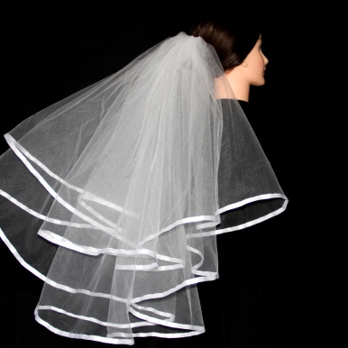 White on White (00KB17N101) - This circular-style veil falls in two ribbon-edged tiers.