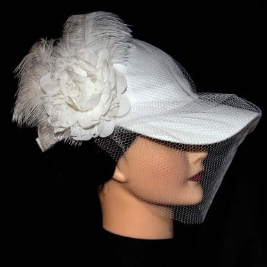 00KB17S101 - The baseball cap birdcage veil is elegant enough to please traditional family members while feeling comfortable enough for you.