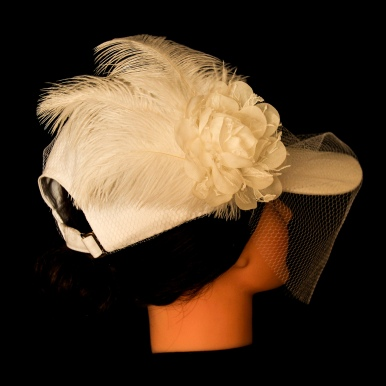 00KB17S101 - The baseball cap birdcage veil is elegant enough to please traditional family members while feeling comfortable enough for you. (back view)